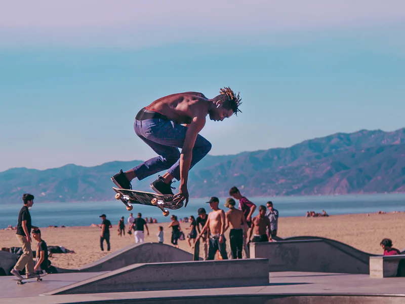 A Black skateboarder getting some air time