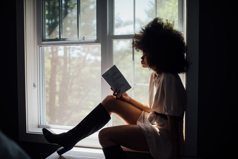 black woman reading book