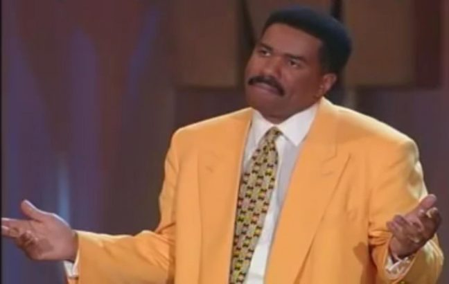 Steve Harvey in a yellow suit (with hair on his head)