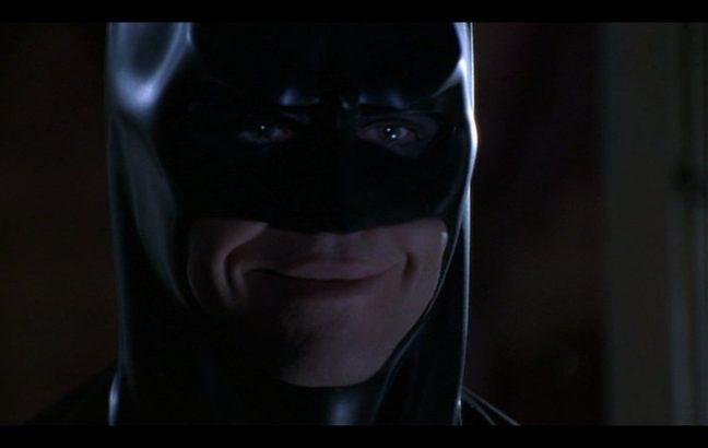 Val Kilmer smiling, as Batman