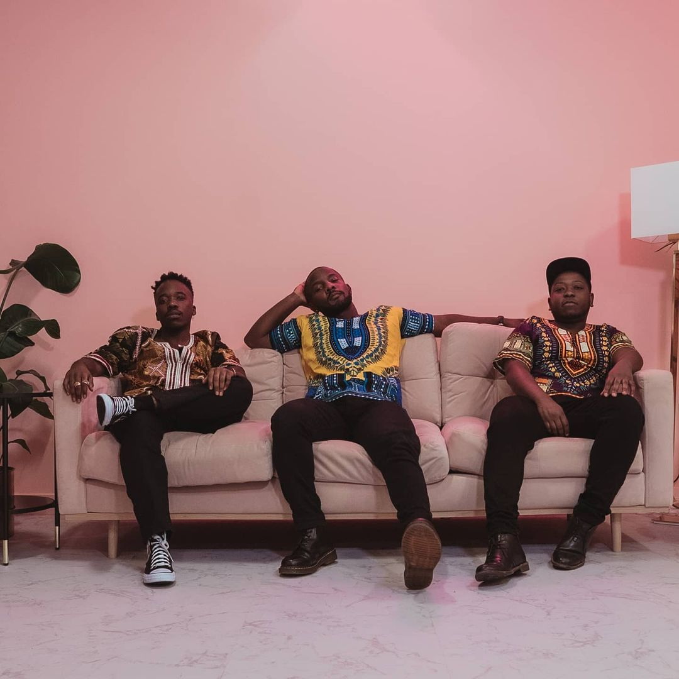 Felix Prince, Thierry Ngutegure, and Tinashe Nyamande sitting on a sofa