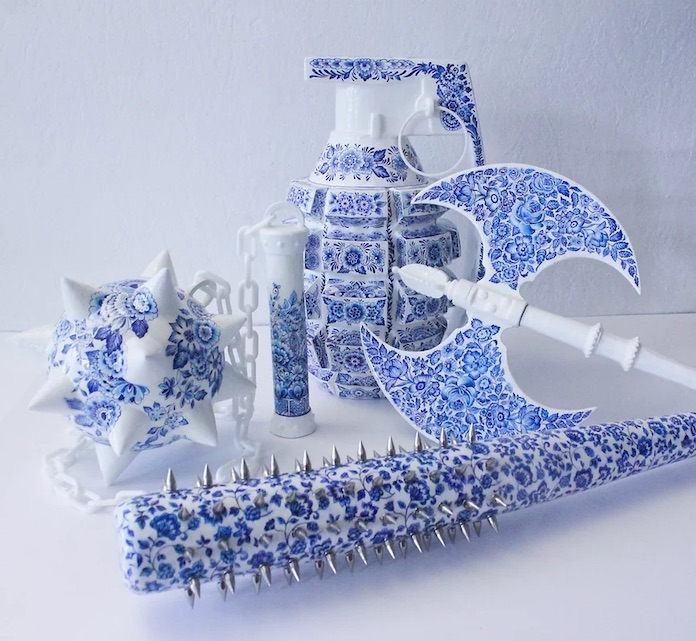 A picture of a blue ceramic grenade, Morning star, spiked baseball bat, and battle axe