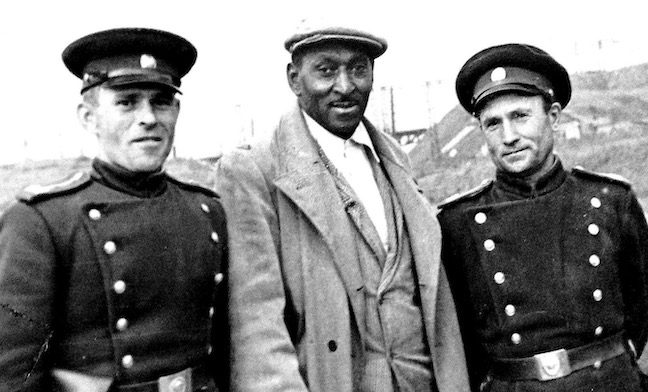 George Tynes, flanked by Soviet army cadets